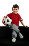 Happy boy sits with the soccer ball Stock Image