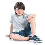 Happy boy sitting Royalty Free Stock Photo
