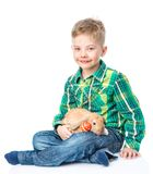 Happy boy sitting with easter eggs and rabbit. Isolated on white Stock Photo