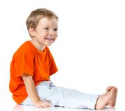 Happy boy sitting on the floor Royalty Free Stock Photo