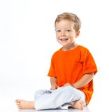 Happy boy sitting on the floor Stock Image