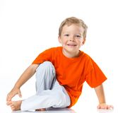 Happy boy sitting on the floor Stock Photography