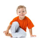 Happy boy sitting on the floor Royalty Free Stock Photos