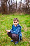 Happy boy sitting in the grass Royalty Free Stock Photos