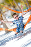 Happy boy sitting in hammock Royalty Free Stock Image