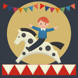 Happy boy sitting on  horse in merry-go-round Royalty Free Stock Photography