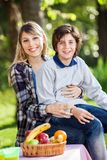 Happy Boy Sitting On Mother's Lap At Campsite Royalty Free Stock Photo