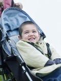 Happy Boy Sitting On Pram Royalty Free Stock Photo