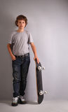 Happy boy on skateboard Stock Photo