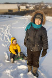 Happy boy with sled Stock Photos