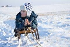 Happy boy on sled Stock Photo