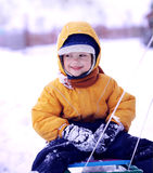 Happy boy with sled Stock Photography
