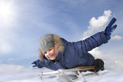 Happy boy on sled Stock Photography