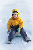 Happy boy  on sled Stock Image