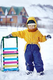 Happy boy with sled Royalty Free Stock Photography