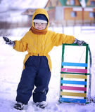 Happy boy with sled Royalty Free Stock Images