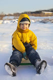 Happy boy on sled Royalty Free Stock Photography