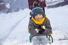 Happy boy with sled Stock Images