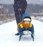 Happy boy with sled Stock Photo