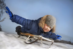 Happy boy on sled Royalty Free Stock Photos