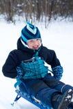 Happy boy sledding Royalty Free Stock Images