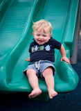 Happy boy on slide Royalty Free Stock Photo