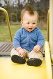 Happy Boy on Slide Stock Photo