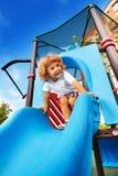 Happy boy sliding Royalty Free Stock Image