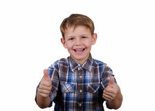 Happy boy with a smile and a gesture like two hands isolate. Cute European boy with a smile on her face and a gesture like two hands on a white background Royalty Free Stock Photography