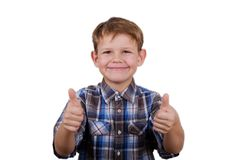 Happy boy with a smile and a gesture like two hands isolate. Cute European boy with a smile on her face and a gesture like two hands on a white background royalty free stock images