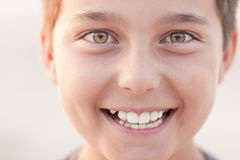Happy boy smiling. Close-up head shot of boy at warm sunset Stock Photos