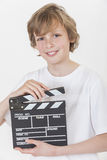 Happy Boy Smiling With Clapperboard Stock Photos