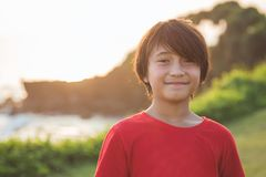 Happy boy smiling. Portrait of happy boy smiling to the camera in the park Stock Images