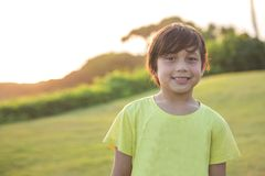 Happy boy smiling. Portrait of happy boy smiling to the camera in the park Royalty Free Stock Photography