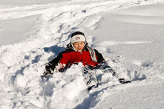 Happy boy is in the snow Stock Photo