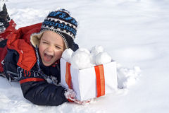 Happy boy in the snow with a box of snowballs Stock Photography