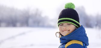 Happy boy in snow play and smile sunny day outdoors stock photos