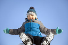 Happy boy in snow play and smile sunny day Stock Images