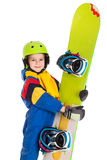 Happy boy with snowboard. Happy boy standing with snowboard, isolated on white Royalty Free Stock Photo