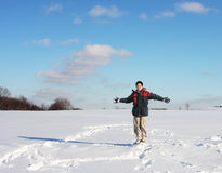 Happy Boy on snowfield. A happy boy dancing on a snowfield Stock Photo