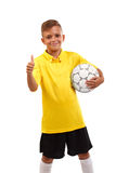 A happy boy with a soccer ball and in a football uniform isolated on a white background. The winner took the first place Royalty Free Stock Photos