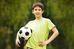 Happy boy with a soccer ball Royalty Free Stock Image