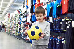 Happy boy with soccer ball in sport store Stock Image