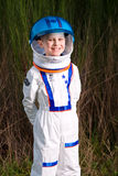 Happy boy in spaceman suit Stock Photos