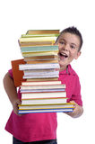 Happy boy with stack of books Royalty Free Stock Images