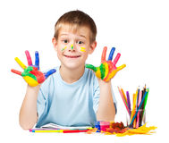 Happy boy with stained coloured hand Royalty Free Stock Images