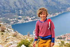 Happy boy standing in mountains Royalty Free Stock Image