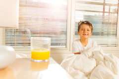 Happy boy starting his morning with glass of juice Royalty Free Stock Photo