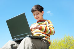 Happy boy studies outside Stock Photo