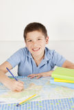Happy boy studying Royalty Free Stock Images